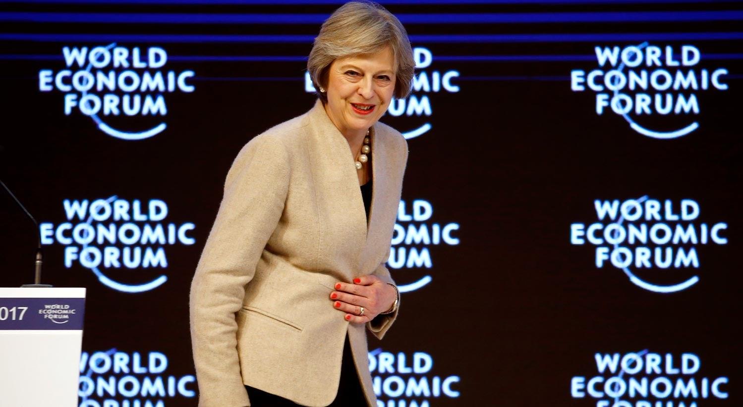 Mundo - Theresa May diz que Brexit não significa virar costas à Europa