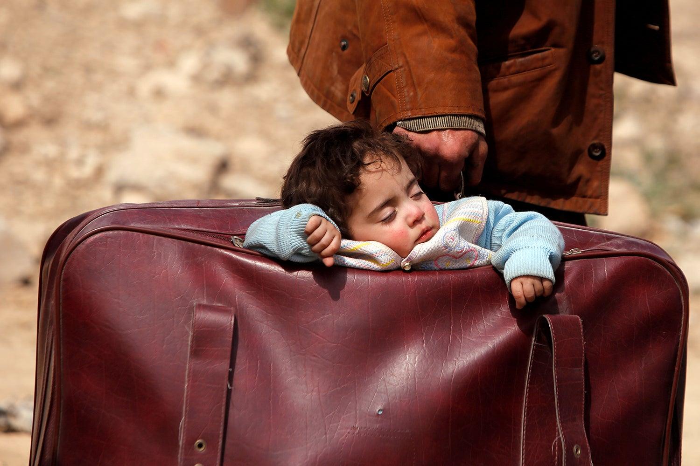 Êxodo de Ghouta na Síria /Omar Sanadiki - Reuters