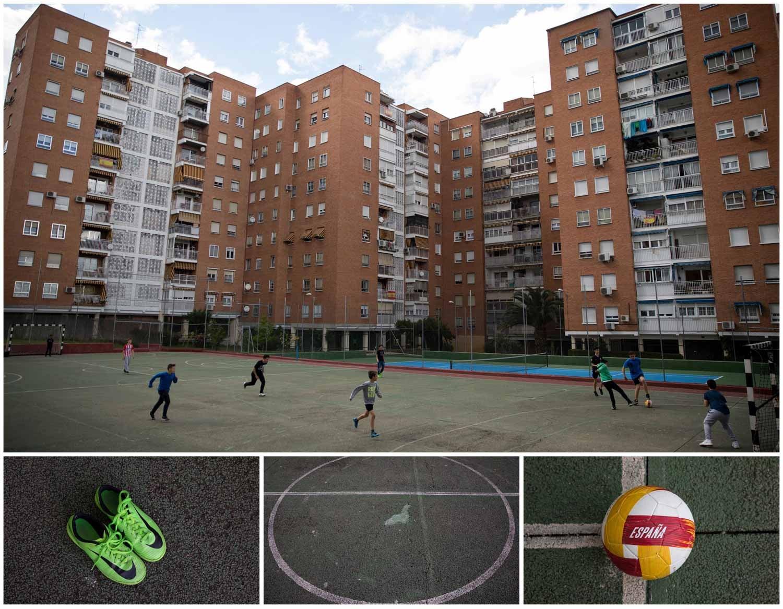 Em Madrid, capital espanhola, um grupo de crianças joga futebol num campo escondido entre prédios. Foto: Sergio Perez - Reuters