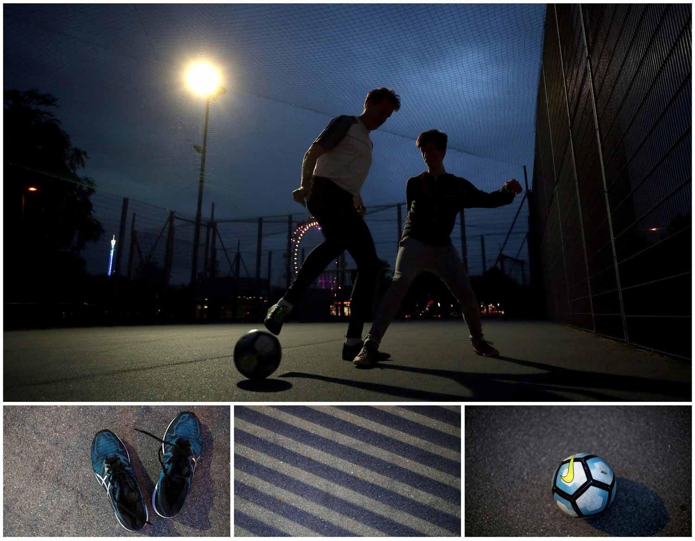 Durante a noite também se joga futebol. Dois jovens disputam uma bola num campo  em frente à roda gigante de Vienna, na Áustria. Foto: Lisi Niesner - Reuters