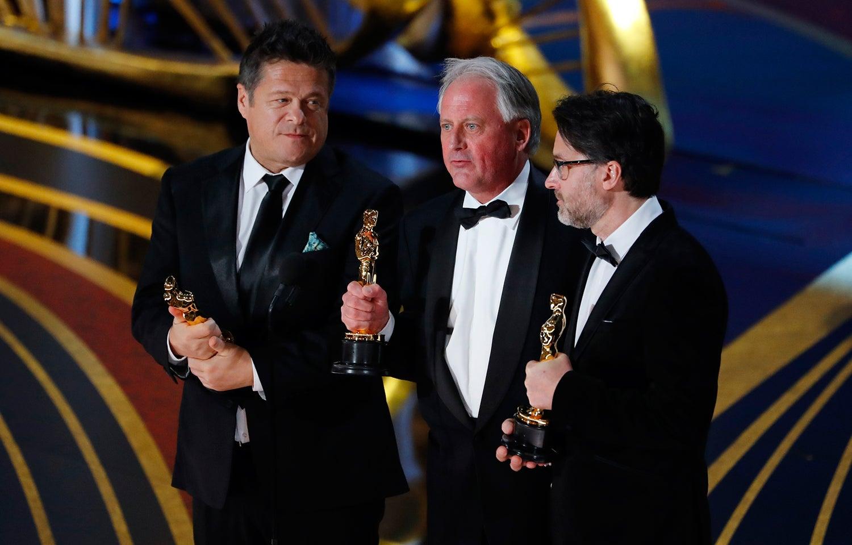 Paul Massey, Tim Cavagin e John Casali /Mike Blake - Reuters