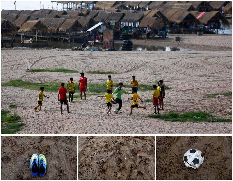No Camboja, ao longo das margens do rio Mekong, nos arredores de Phnom Penh, um grupo de crianças joga futebol na areia. Foto: Pring Samrang - Reuters