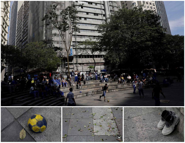 No Rio de Janeiro, no Brasil, vários construtores civis aproveitam a pausa de almoço para jogarem uma partida de futebol. O prédio em construção aparece nas traseiras. Foto: Ricardo Moraes - Reuters