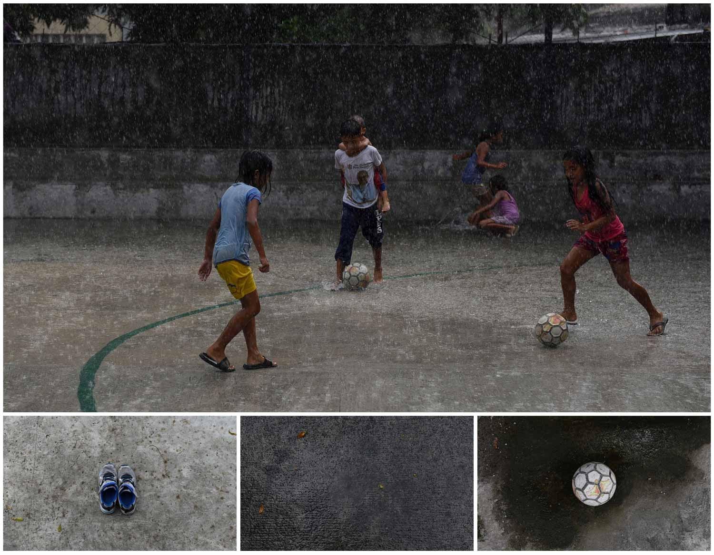 A chuva não é impedimento para uma partida de futebol entre crianças na Cidade Quezon, nas Filipinas. Foto: Dondi Tawatao - Reuters