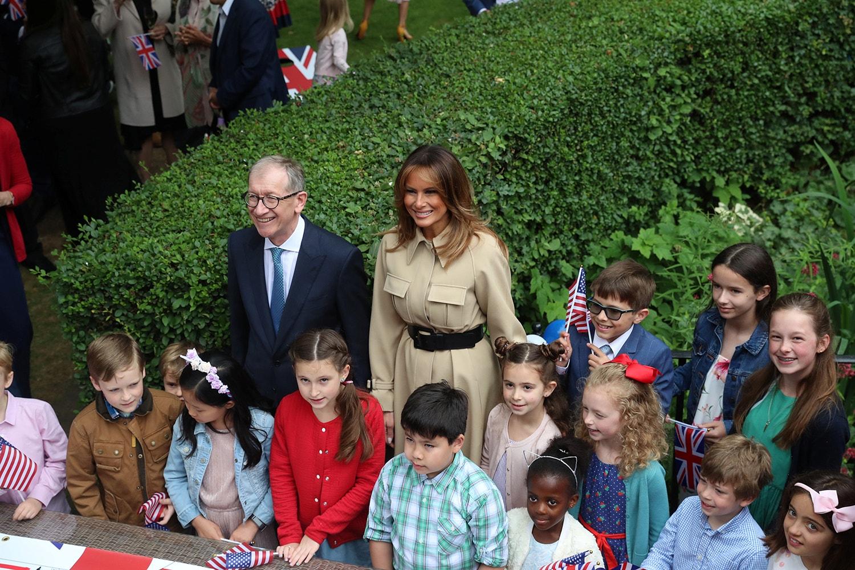 Melania Trump e Philip May participaram numa uma festa no jardim de Downing Street /Simon Dawson - Reuters