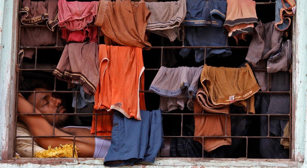 Bombaim. Morador da favela Dharavi | Danish Siddiqui - Reuters