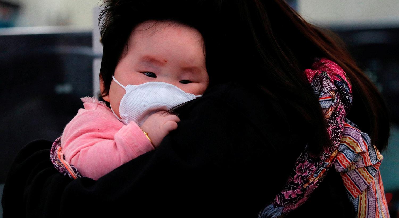 Em Hong Kong por prevenção todos usam máscaras. | Tyrone Siu - Reuters