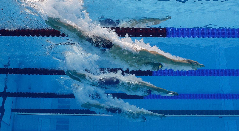 400m de natação livre. Kregor Zick da Estónia, Zac Reid da Nova Zelândia e Henrik Christiansen da Noruega em acção.   Foto: Stefan Wermuth - Reuters
