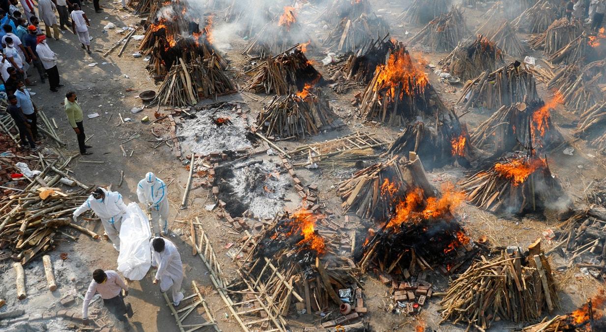 Nova Deli. Familiares despedem-se dos entes queridos | Adnan Abidi - Reuters