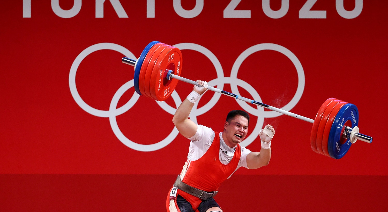 Levantamento de Peso. Reação do atleta do Quirguistão.   Foto: Edgard Garrido - Reuters